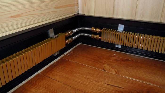 плинтусная ситема отопления жидкостный радиатор